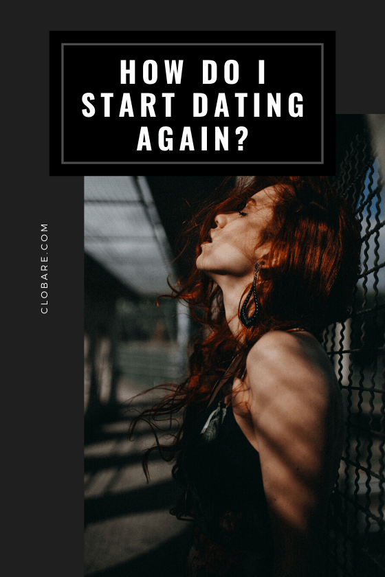 "Woman leans her head against a chainlink fence with her red hair blowing around her as she thinks ""how do I start dating again?"""