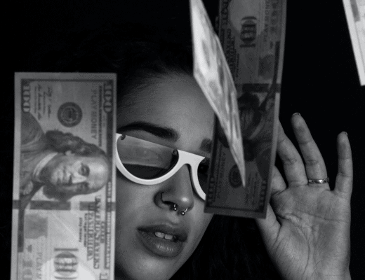how to manage money woman with money flying around her face